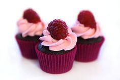 Mini chocolate cupcakes with raspberries.