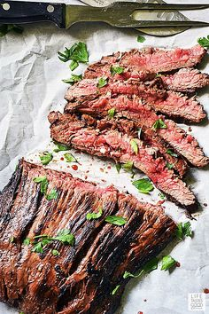 Slice cast iron flank steak thinly across the grain for maximum tenderness Flat Iron Steak Marinade, Cast Iron Flank Steak, Steak Taco Marinade, Cast Iron Skillet Steak, Flank Steak Tacos, Marinated Flank Steak, Steak Fajitas, Steak Marinades, Thin Steak Recipes