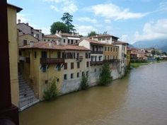 View from Ponte degli Alpini in Bassano del Grappa. We visit, and sample the wonderful grappas made here on our bike tours. Bike the wine roads in Italy, cycle and cook on our Chefs on Bike tours, or challenge yourself in the Dolomites with Italiaoutdoors.