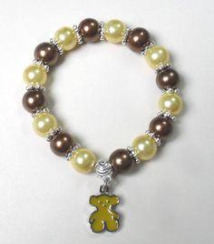 pulsera elasticada en perlas conbinadas y dije acero tous diseño de color beads.
