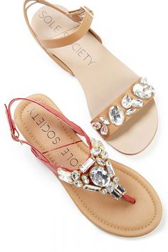 Flat sandals bejeweled with sparkling crystal stones. A spring/summer essential. ==