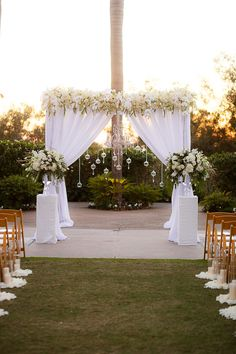 Glamorous draped ceremony arbor: http://www.stylemepretty.com/california-weddings/2016/03/25/elegant-new-years-eve-wedding-3/ | Photography: The Youngrens - http://theyoungrens.com/