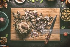 Stock Photo : Artichokes with knife on cutting board , cooking preparation Artichokes, Royalty Free Images, Cutting Board, Stock Photos, Cooking, Cuisine, Artichoke, Kitchen, Cutting Tables