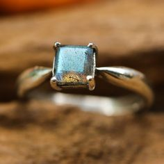 Square labradorite in silver bezel and prongs setting with sterling silver high polished band