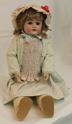 "Estimated Price: $150 - $200 Description: 29"" GERMANY S (PB In Star)B 914 11 BISQUE HEAD DOLL. Blue sleep eyes with fluffy lashes, open mouth, brown mohair wig. Papier mache ball jointed body. Doll is dressed in vintage child's white cotton dress; ivory cloth shoes. Newer bonnet, petticoat, no underpants. Condition: mold imperfection in front of right ear. Chip on rim edge. Shoe soles are missing."