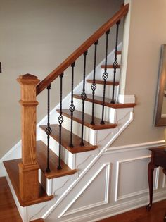 New stairway, new railing, wainscoting, wrought iron balusters, SW Pavilion Beige paint.