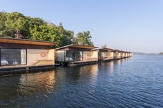 Image 28 of 57 from gallery of Resort / Dersyn Studio. Photograph by Beer Singnoi Huts On The Water, Studio 57, Floating Architecture, Hudson Homes, Riverside House, Architecture Concept Drawings, Hotel Concept, Lake Resort, Floating House
