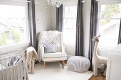 If ever there were a nursery destined for greatness, it would be this little spot. It's a calming baby oasis filled with cozy rugs and fluffy stuffed animals, crafted by parents to be, Steve and Jamie of Sinclair & Moore Events. These two