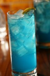 Blue Motorcycle-   1 1/2 oz Vodka 	  1 1/2 oz Tequila 	  1 1/2 oz Blue Curacao 	Liqueur  1 1/2 oz Gin 	  1 1/2 oz Rum 	  1 splash 7 Up 	Mixer  (Fill to Top) Sweet and Sour Mix