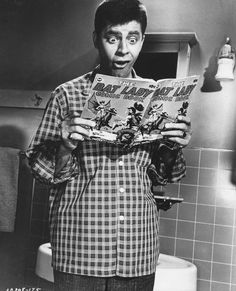 Artists and Models (1955) | Publicity photo: Jerry Lewis reading a Bat Lady comic book