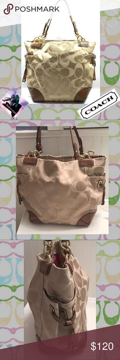 Coach Peyton Signature Khaki Tote 14505 EUC October 2009 Fall Release. EUC . Handles show the very slightest handle wear. See photos. -Khaki fabric - Brown Leather - 2 sided pockets - Salmon satin fabric within - Zipper pouch within - Clip closure - (L) 14 x (H) 12 x (W) 5 inchestrades. Please ask all questions prior to buying. Coach Bags Totes