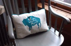 "Lonely Buffalo Pillow cream and teal by hammerandfox on Etsy, ""This little buffalo pillow pays homage to these lovely burly creatures, with hand lettering and a solitary silhouette. Measuring 16 x 11 x 3 inches, this pillow is hand screenprinted in teal ink on cream colored cotton with teal piping, and stuffed with soft polyfill. Bring one into your home and give the buffalo some love!"""