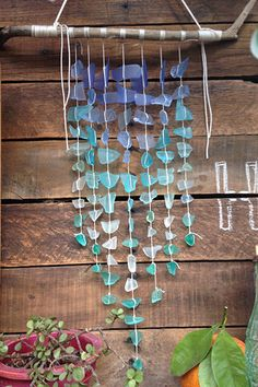 For a beach wedding, why not carry a sea glass wind chime instead of a traditional bouquet?
