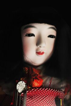 Ichimatsu Doll 市松人形 represent little girls or boys, correctly proportioned and usually with flesh-colored skin and glass eyes. The original Ichimatsu were named after an 18th-century Kabuki actor, and must have represented an adult man, but since the late 19th century the term has applied to child dolls, usually made to hold in the arms, dress, and pose.