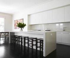 JO MCINTYRE . Victoria . Surrey Hills House . Kitchen Interior. Like recessed, no handles overhead cupboards.
