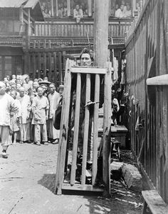 A man convicted of murder is imprisoned in a wooden cage on a street in China. He will be left to die of thirst, starvation and exposure.