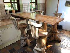 Greenwood diner table annex bar (height is 111 cm). The top is made from Israeli cedar and the leg of round sweet chestnut wood.
