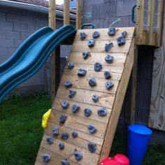 DIY climbing wall.... this would be a great idea for Jeff to do on the new swingset.