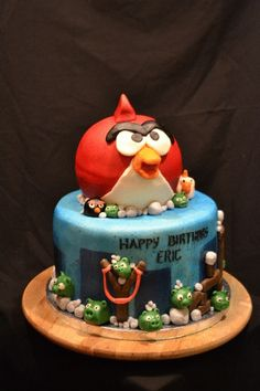 Angry Bird Cake I made with @Kimberly Smith.  Peanut Butter & Jelly cake with buttercream fondant.  What a fun cake this was!
