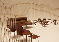 Chocolatey waves are formed by 2,000 chocolate-coloured pipes in this installation by Nendo.