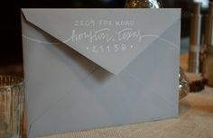 grey envelope return address with white lettering calligraphy