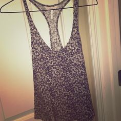 Floral Tank It fits like a small as well as extra small. It has never been worn at all and in great condition! Cute for the summer! Kirra Tops Tank Tops