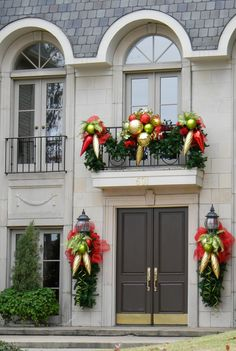 Love the look of the lantern decorations beside the door. This would work for ours!