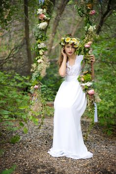 91c009b296e Beautiful spread of wedding flowers in a fairytale themed floral  arrangement with wooden flower swing and