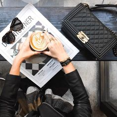 Focus on accessories: cat eye sunglasses, layered rings, leather wrap bracelets, quilted chain strap shoulder bag, oh, and latte to go with your black leather moto jacket.