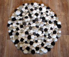 The Rug made of soft pom poms will be a centerpiece of your bedroom. Different sizes, 7 shades of coffee, milk, chocolate) It looks beautiful and unusual - it will become a unique decoration of your room. Diameter of rugs: 30 / 76cm - The term of production up to 2 weeks 35 / 89 cm - The