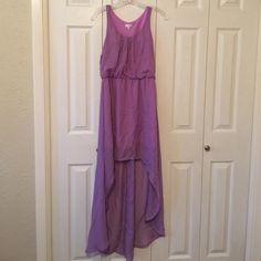 High-Low dress Purple high-low dress from Charming Charlie! Size: Small. Worn once and still in perfect condition! Shorter in the front then it gets longer toward the back. It gathers in the waist for a perfect hourglass figure and it has an embellished neckline. Perfect to wear for Easter Sunday!!  Charming Charlie Dresses High Low