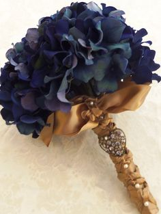 Blue hydrangeas with a touch of gold.