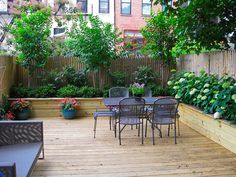 Townhouse garden-Love the idea of raised planters that surround entire outdoor area