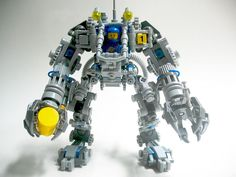 https://flic.kr/p/obZd8V | LEGO Exo Suit Modification Front | I have been having tons of fun playing around with the newly released LEGO Exo Suit set by Peter Reid and Mark Stafford. I have also done some modifications to the set to make it even more to my liking. Here you can see the Exo Suit from the front. First of all, I have replaced all trans-yellow parts with blue. I liked the trans-yellow, but wanted to match my Exo Suit more to LEGO Classic Space, thus blue was added. The cockpit…