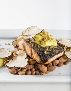 Grilled Salmon with Toasted Black Truffles, East Indian Spinach Puree and Local Beans.