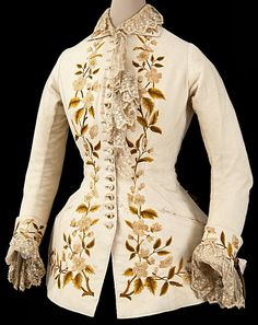 White wool cuirass bodice with silk floral embroidery. circa 1879-82.