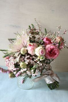 G Lily's stunning 'Shades of Pink' spring bouquet, containing rose genestra, veronica viburnum, heather and blooms.