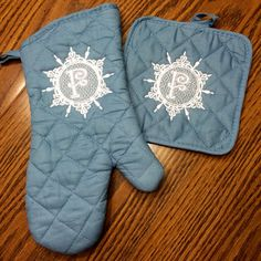 Dollar Tree oven mitt and hot pad.  Elegant Embossed Snowflake monogram from JuJu Designs. Metro thread. Embrilliance software. Brother PE770 embroidery machine.