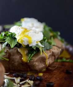 How sweet it is::cheesy black bean stuffed sweet potatoes with arugula and poached eggs