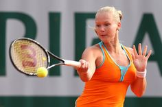 Kiki Bertens of Netherlands plays a forehand in her Women's Singles match against Sorana Cirstea of Romania during day one of the French Open at Roland Garros on May 26, 2013 in Paris, France.