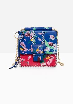 & Other Stories image 1 of Floral Buckle Mini Bag in Blue/Red