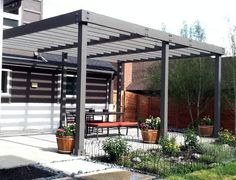 Arbor, pergolas, and shade structures can be designed and installed in many ways. Here a clean modern look was used to work with the archite.