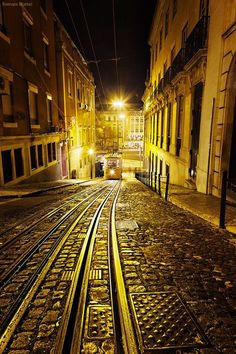 crescentmoon06:      Golden rails - an old neighborhood of Lisboa at night, Portugal