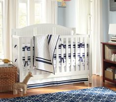 Catalina Fixed GAte 3-In-1 Crib.  Also comes in dark finish.  $499 at Pottery Barn Kids