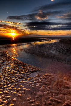 by Adrian Evans    Sunset over Rhyl beach, north Wales, UK