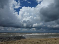 Cumulus clouds over the beach    www.wunderground.com