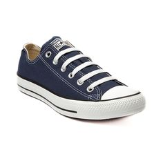 Shop for Converse All Star Lo Sneaker in Navy at Journeys Shoes. Shop today for the hottest brands in mens shoes and womens shoes at Journeys.com.The All Star knows no bounds. From b-ball courts  to punk clubs. From skateparks to school yards. The Converse All Star has come a long way, and its ready to take you even further. The original Old School never lets up. Navy blue canvas upper. Please note that this shoe runs a half size large.