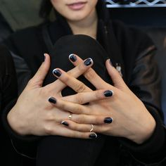 When in doubt, just go with classic black and white. But for some extra oomph, take notes from nailguru Jin Soon Choi, of JINsoon, who created a modern interpretation of the classic French manicure. Apply 2 coats of ametallic black polishand finish off the look with thinwhitecrescents along the tips. via StyleList | http://aol.it/1kio3aH