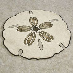 Turn your floor into the ocean shore with the Sand Dollar Shaped Round Rug. The wool rug, hand-hooked in China, appears as if it's a beached sand dollar bleached by the sun's rays. Colored in shades of light cream with darker spots of brown, gray, and taupe that mimic a sand dollar's natural shape, this rug is sure to bring the feel of the beach to any room. Shag Carpet, Diy Carpet, Wall Carpet, Modern Carpet, Rugs On Carpet, Carpet Ideas, Carpet Decor, Outdoor Carpet, Berber Carpet
