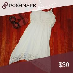 ??White Crochet sun dress Light and airy. This dress is lined and has an overlapping top layer. Beautiful crochet details. Charming Charlie Dresses Midi